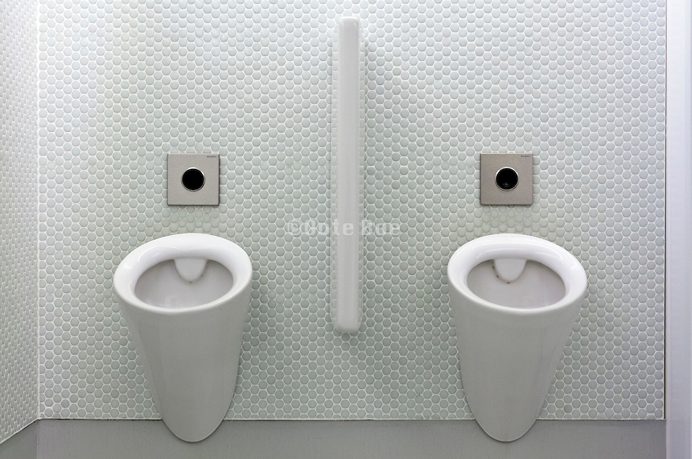 row with two urinals at a male public toilet