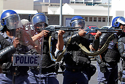 Wednesday 26 October 2016.<br /> Parliament, Cape Town,<br /> Western Cape,<br /> South Africa<br /> <br /> Fees Must Fall Protest March In Cape Town.<br /> <br /> Police fire rubber bullets at students and protesters outside Parliament in Cape Town after a clash with students who threw a burning cardboard coffin at the Police. This action caused the Police to retaliate and disperse students and other protesters with stun grenades and shooting rubber bullets.<br /> <br /> Students and supporters march to parliament in protest against higher education fees in South Africa on the 26th October 2016. The students are protesting against the fees for higher education. This protest is part of the #FeesMustFall campaign.<br /> <br /> Picture By: Mark Wessels/ RealTime Images.