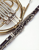 Clarinet and french horn shot on a white background.