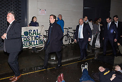 London, UK. 26 November, 2019. Activists from Global Justice Rebellion and London Mining Network protest outside the Mines and Money awards ceremony at the Honorary Artillery Company as mining company delegates, investors and government representatives arrive. The activists were protesting to highlight the environmental impact of mining and also the manner in which mining companies are increasingly attempting to 'greenwash' their activities by claiming that they are indispensable in a transition to sustainables.