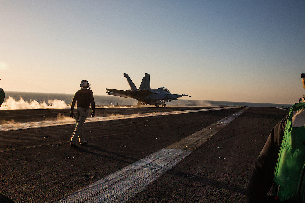 A F/A-18 Hornet part-way through a launch off one of the two belly catapults<br /> <br /> Aboard the USS Harry S. Truman operating in the Persian Gulf. February 25, 2016.<br /> <br /> Matt Lutton / Boreal Collective for Mashable