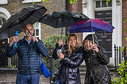 Licensed to London News Pictures. 17/05/2021. London, UK. Pub drinkers get caught in torrential rain in Richmond, south west London as the miserable May weather drags on. Today Government's roadmap out of lockdown continues with pubs, restaurants, cafes and bars able to serve customers inside. However Downing Street has warned that due to the Indian variant, local lockdowns could be quickly reintroduced in high risk areas. Photo credit: Alex Lentati/LNP