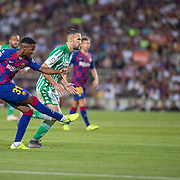 BARCELONA, SPAIN - August 25:  Anssumane Fati #31 of Barcelona shoots while defended by Alfonso Pedraza #6 of Real Betis during the Barcelona V  Real Betis, La Liga regular season match at  Estadio Camp Nou on August 25th 2019 in Barcelona, Spain. (Photo by Tim Clayton/Corbis via Getty Images)