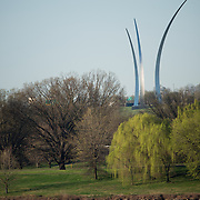 Rowers out training on the Potomac in the morning in the spring, with the Air Force Memorial in the background.