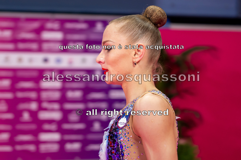 Ekaterina Vedeneeva sitting at the Kiss and Cry of the Rhythmic Gymnastics World Cup in Pesaro.