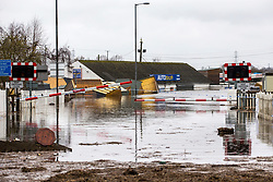 © Licensed to London News Pictures. 28/02/2020. Snaith UK. A flooded rail crossing in Snaith where residents have been evacuated from flood water in Yorkshire as the UK prepares for storm Jorge. Photo credit: Andrew McCaren/LNP