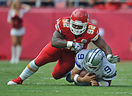 KANSAS CITY, MO - SEPTEMBER 15:  Nose tackle Dontari Poe #92 of the Kansas City Chiefs tackles quarterback Tony Romo #9 of the Dallas Cowboys after a short gain during the second half on September 15, 2013 at Arrowhead Stadium in Kansas City, Missouri.  Kansas City defeated Dallas 17-16. (Photo by Peter Aiken/Getty Images) *** Local Caption *** Dontari Poe;Tony Romo