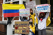 Protesters hold signs and a Colombian flag at a Free Palestine SOS Colombia rally in solidarity with the Palestinian and Colombian peoples outside the Colombian embassy on 15th May 2021 in London, United Kingdom. Speakers at the event, which took place on Nakba Day and also included a march to the Israeli embassy, highlighted human rights abuses being directed against Palestinians in Israel and the Occupied Territories, in particular attempts at forced displacements in Sheikh Jarrah in East Jerusalem, and also in Colombia, where peaceful demonstrators and human rights defenders have been killed and subjected to repression, detention and torture.