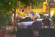 Outside seating terrasse at the restaurant. Guests having dinner. Restaurant Restoran Rondo on the Rondo Square Historic town of Mostar. Federation Bosne i Hercegovine. Bosnia Herzegovina, Europe.