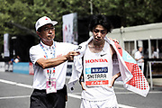 Yuta Shitara reacts after placing 14th in the men's race in 2:16:09 during the Marathon Grand Championship, Sunday Sept. 15 2019, in Tokyo. (Agence SHOT/Image of Sport via AP)