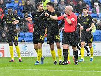 Football - 2019 / 2020 Sky Bet (EFL) Championship - Cardiff City vs. Brentford<br /> <br /> referee Mr Hooper speaks to \22\ in rain, sleet & hail  , at The Cardiff City Stadium.<br /> <br /> COLORSPORT/WINSTON BYNORTH