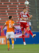 FRISCO, TX - JUNE 12:  Matt Hedges #24 of FC Dallas clears the ball against Will Bruin #12 of the Houston Dynamo on June 12, 2013 at FC Dallas Stadium in Frisco, Texas.  (Photo by Cooper Neill/Getty Images) *** Local Caption *** Matt Hedges; Will Bruin