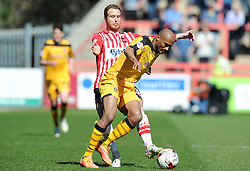 Newport County's Chris Zebroski is tackled by Exeter City's Ryan Harley - Photo mandatory by-line: Harry Trump/JMP - Mobile: 07966 386802 - 06/04/15 - SPORT - FOOTBALL - Sky Bet League Two - Exeter City v Newport County - St James Park, Exeter, England.