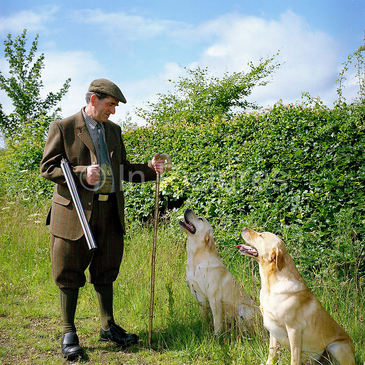Portrait of gamekeeper Ronnie Grigor and his dogs Jasper and Max at Fala estate, Midlothian, Scotland. Fala estate supplies game such as roe deer (venison), hares, rabbits and wood pigeons to local restaurants.