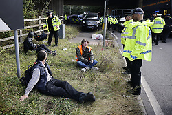 © Licensed to London News Pictures. 29/09/2021. Swanley, UK. Police detain activists from the Insulate Britain climate change protest group as they block the road near to junction 3 of the M25 motorway near Swanley for the second time today. 11 members of the campaign group were detained at the same junction earlier today. This is the seventh time in just over two weeks that activists have disrupted traffic on London's orbital motorway despite the government being granted a temporary High Court Injucntion banning the group from protesting on the M25. 50 protesters who were detained after Monday's protest, on junction 14 of the M25 at Heathrow, were released. Photo credit: Peter Macdiarmid/LNP
