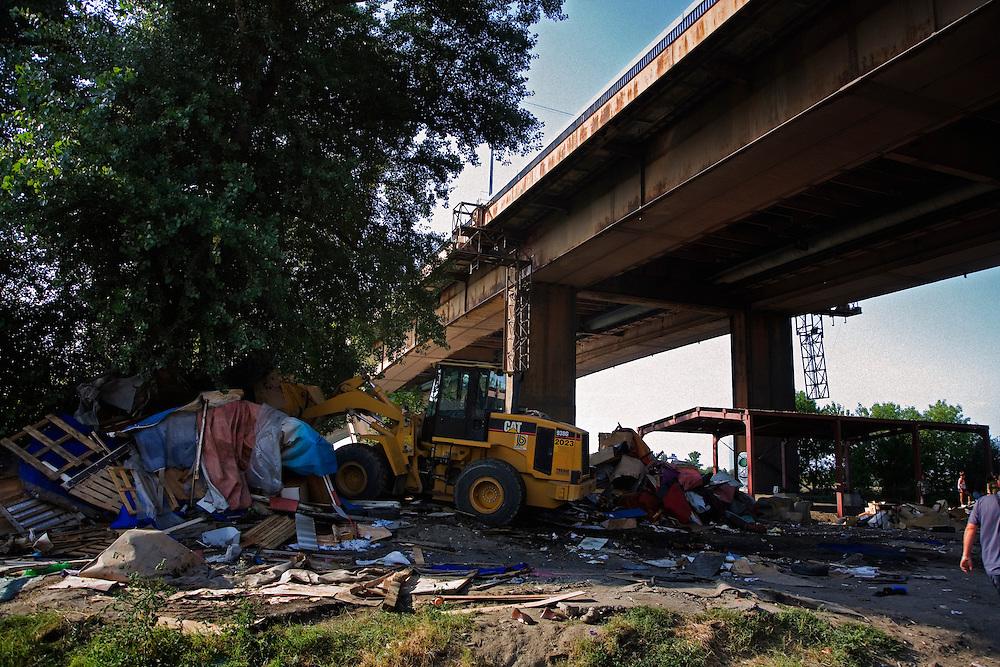 A bulldozer flattens a home in the Stara Gazela camp immediately below the Gazela bridge.