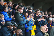 AFC Wimbledon fans clapping during the The FA Cup 5th round match between AFC Wimbledon and Millwall at the Cherry Red Records Stadium, Kingston, England on 16 February 2019.