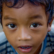 Curious young Cambodian boy (, Cambodia - Oct. 2008) (Image ID: 081027-0742171a)