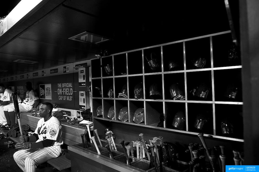 Yoenis Cespedes, New York Mets, preparing to bat in the dugout during the New York Mets Vs Atlanta Braves MLB regular season baseball game at Citi Field, Queens, New York. USA. 22nd September 2015. Photo Tim Clayton