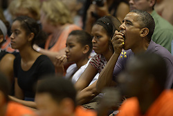 US President Barack Obama and First Lady Michelle Obama with daughters Malia and Sasha attend the Oregon State vs Akron college basketball game at the Diamond Head Classic tournament at Manoa Stan Sheriff Center in Honolulu, Hawaii, USA on December 22, 2013. Oregon State is coached by Michelle Obama's brother, Craig Robinson. Photo by Cory Lum/ABACAPRESS.COM  | 427442_009 Honolulu Etats-Unis United States
