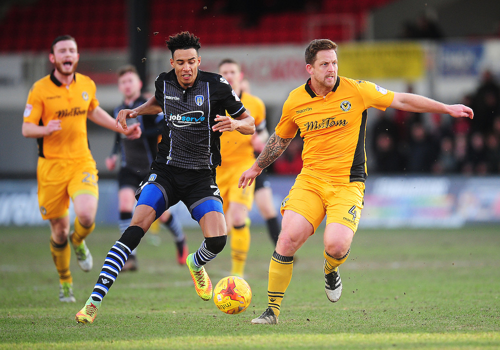 Colchester United's Kurtis Guthrie vies for possession with Newport County's Darren Jones<br /> <br /> Photographer Kevin Barnes/CameraSport<br /> <br /> The EFL Sky Bet League Two - Newport County v Colchester United - Saturday 14th January 2017 - Rodney Parade - Newport<br /> <br /> World Copyright © 2017 CameraSport. All rights reserved. 43 Linden Ave. Countesthorpe. Leicester. England. LE8 5PG - Tel: +44 (0) 116 277 4147 - admin@camerasport.com - www.camerasport.com
