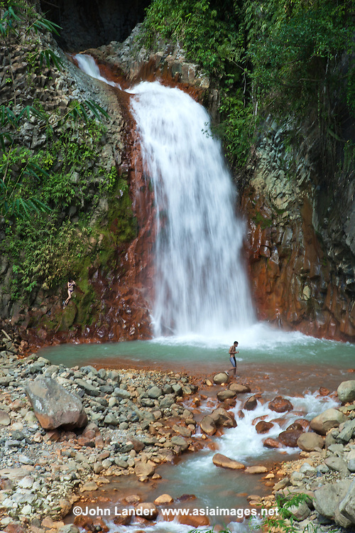 """Pulangbato Falls.or as it is sometimes called """"Twin Falls"""" is one of the most popular destinations in Valencia. Pulangbato Falls is a cascade that is high in iron content, rusting the cliff in its path creating an awesome two toned waterfalls."""