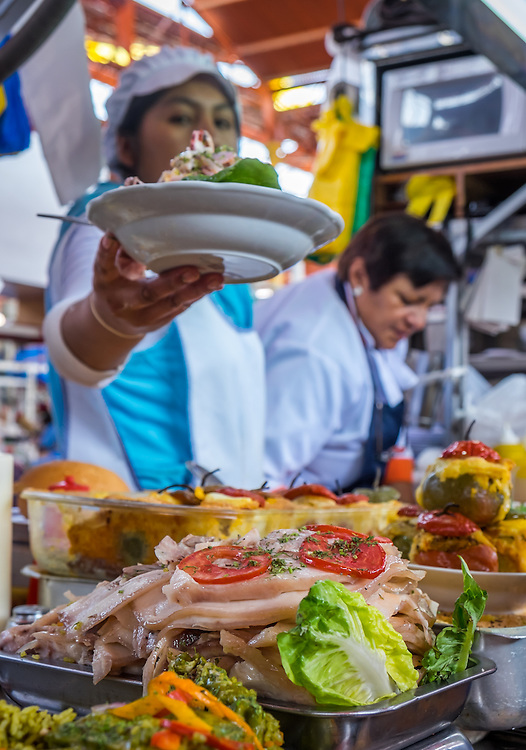 AREQUIPA, PERU - CIRCA APRIL 2014: Woman serving ceviche at the San Camilo market in Arequipa. Arequipa is the Second city of Perú by population with 861,145 inhabitants and is the second most industrialized and commercial city of Peru.
