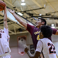 Tohatchi Cougar Rooster Yazzie (44) looses a rebound to Gallup Bengal Tyrell Begay (23) Thursday at Gallup High School.