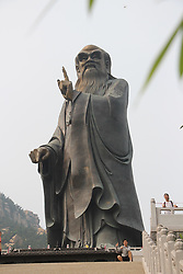 August 17, 2017 - Qingdao, Qingdao, China - Qingdao, CHINA-16th August 2017: (EDITORIAL USE ONLY. CHINA OUT)..The 50-meter-tall world's largest Laozi statue can be seen at Lao Mountain in Qingdao, east China's Shandong Province. Laozi, also known as Lao-Tzu, was an ancient Chinese philosopher and writer. He is known as the reputed author of the Tao Te Ching, the founder of philosophical Taoism, and a deity in religious Taoism and traditional Chinese religions. (Credit Image: © SIPA Asia via ZUMA Wire)