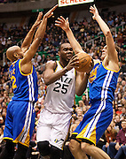 Jazz center Al Jefferson (25) drives the lane during the first half of the NBA basketball game between the Utah Jazz and the Golden State Warriors at Energy Solutions Arena, Wednesday, Dec. 26, 2012.