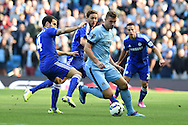 Edin Dzeko of Man city holds off Chelsea's Cesc Fabregas (l). Barclays premier league match, Manchester city v Chelsea at the Etihad stadium in Manchester,Lancs on Sunday 21st Sept 2014<br /> pic by Andrew Orchard, Andrew Orchard sports photography.