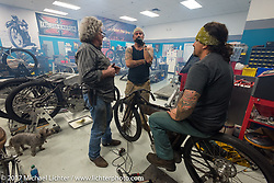 Billy Lane of Chopper's Inc (R) with his brother Warren and Berry Wardlaw (L) take a short break from round the clock work in Billy's shop for Saturday's Sons of Speed Race of nearly century old boardtrack style bikes at New Smyrna Speeday during Daytona Beach Bike Week. FL. USA. Tuesday, March 14, 2017. Photography ©2017 Michael Lichter.