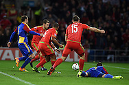 The ball falls to Aaron Ramsey of Wales to score his teams 1st goal. Wales v Andorra, Euro 2016 qualifying match at the Cardiff city stadium  in Cardiff, South Wales  on Tuesday 13th October 2015. <br /> pic by  Andrew Orchard, Andrew Orchard sports photography.
