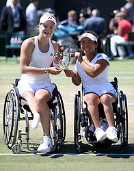 Diede De Groot (left) and Yui Kamiji with the trophy after winning the Ladies' Wheelchair Doubles on day thirteen of the Wimbledon Championships at the All England Lawn Tennis and Croquet Club, Wimbledon. PRESS ASSOCIATION Photo. Picture date: Sunday July 15, 2018. See PA story TENNIS Wimbledon. Photo credit should read: Steven Paston/PA Wire. RESTRICTIONS: Editorial use only. No commercial use without prior written consent of the AELTC. Still image use only - no moving images to emulate broadcast. No superimposing or removal of sponsor/ad logos. Call +44 (0)1158 447447 for further information.
