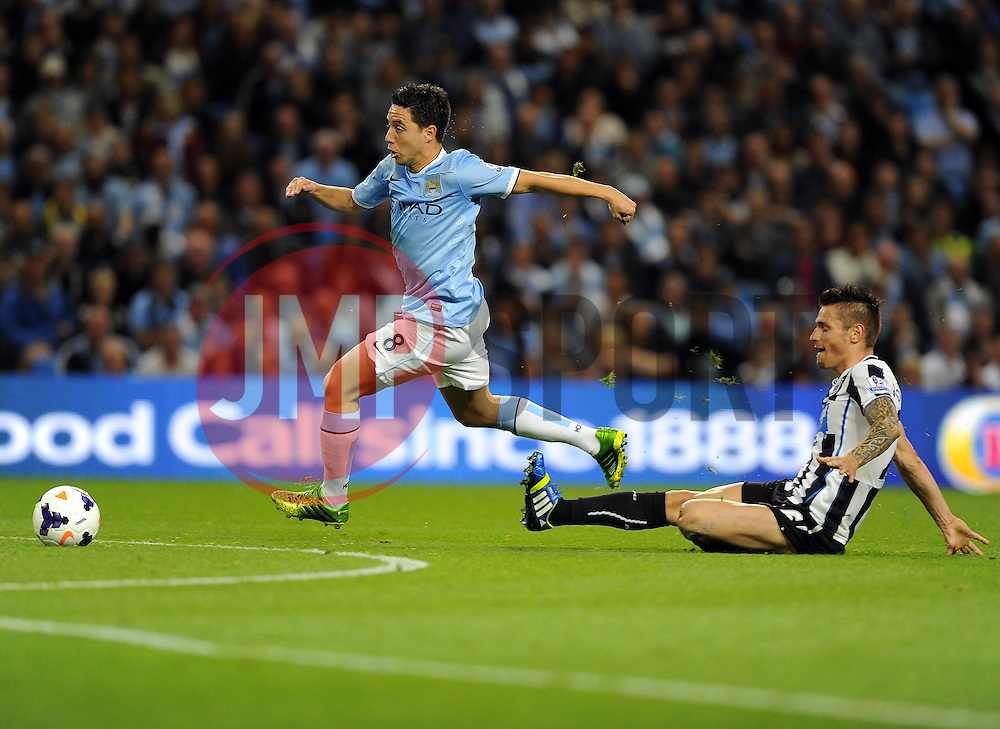 Manchester City's Samir Nasri escapes the attentions off Newcastle United's Mathieu Debuchy to score  - Photo mandatory by-line: Joe Meredith/JMP - Tel: Mobile: 07966 386802 19/08/2013 - SPORT - FOOTBALL - Etihad Stadium - Manchester - Manchester City V Newcastle United - Barclays Premier League