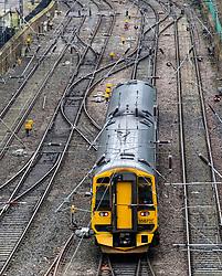 Scotrail passenger train leaving Waverley Station in Edinburgh, Scotland, United Kingdom