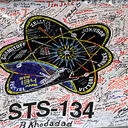 A banner hangs from the shuttle crawler with  signatures from NASA employees as  Endeavour rolls out to launch pad 39A at the Kennedy Space Center in Cape Canaveral, Fla., on Thursday, March 10, 2011.  (AP Photo/Alex Menendez)