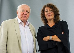 """Pictured: Elisabeth Asbrink and Jonathan Fenby<br /> <br /> Elisabeth Katherine Åsbrink (born 29 April 1965) is a Swedish author and journalist. She made her debut with the book Smärtpunkten - Lars Norén, pjäsen Sju tre och morden i Malexander. The book was nominated for the August prize for non-fiction in 2009, and is translated into Polish. In 2010 she received the Jarl Alfredius stipendium with the motivation: """"time after time she manages to treat contemporary social issues with great curiosity and sensitivity""""<br /> <br /> Jonathan Fenby, CBE (born 11 November 1942) is China Chairman and Managing Director, European Politics at the research service TSLombard. He was previously a founding partner and managing director of the China team at Trusted Sources an emerging markets research and consultancy firm headquartered in London before it merged with Lombard Street Research in 2016. His investment and strategy research is focused towards policy interpretation, politics and broader political economy including East Asian politics and strategy. He is also an author and journalist."""