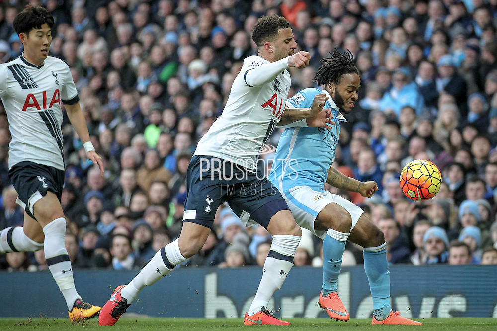 Raheem Sterling (Manchester City) tries to hold off Dele Alli (Tottenham Hotspur) during the Barclays Premier League match between Manchester City and Tottenham Hotspur at the Etihad Stadium, Manchester, England on 14 February 2016. Photo by Mark P Doherty.