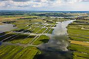 Nederland, Noord-Holland, Gemeente Wormerland, 14-06-2012; Polder Wormer, Jisp en Nek. De verkaveling in het gebied is het resultaat van veenontginning. Links de veenplas De Marken, water van 't Zwet in de voorgrond, lopend naar het dorp Jisp. Links aan de horizon de Beemster met daar achter IJsselmeer..Polder in province North Holland (above Amsterdam) with villages. The division in plots in the area is the result of peat extraction..luchtfoto (toeslag), aerial photo (additional fee required);.copyright foto/photo Siebe Swart