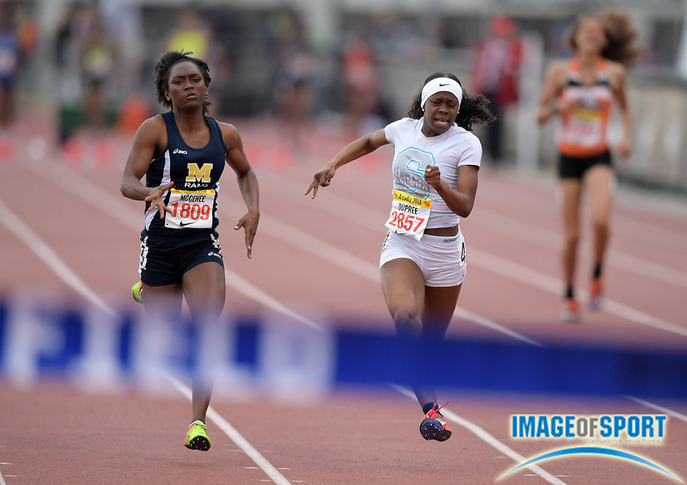 Apr 7, 2018; Arcadia, CA, USA; Imani Dupree (2857) of Sheldon defeats Chudney McGehee (1809) of Millikan to win the seeded girls 100m, 11.94 to 11.97, during the 51st Arcadia Invitational at Arcadia High.