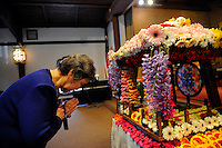 """Noriko Yamashita pays her respects to the baby Buddha at the Buddhist Temple of Salinas. """"Hanamatsuri,"""" or flower festival in Japanese, is also known as Buddha's Birthday, and was celebrated on Sunday."""