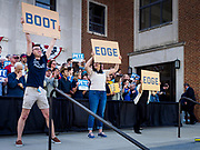 """16 APRIL 2019 - DES MOINES, IOWA: Buttigieg volunteers lead a cheer using flash cards that show how to pronounce Buttigieg during a rally for Mayor Pete Buttigieg, the mayor of South Bend, Indiana. """"Mayor Pete,"""" as he goes by, declared his candidacy to be the Democratic nominee for the US Presidency on April 14. About 1,000 people attended his first rally in Iowa since officially declaring his candidacy. Iowa traditionally hosts the the first selection event of the presidential election cycle. The Iowa Caucuses will be on Feb. 3, 2020.                PHOTO BY JACK KURTZ"""