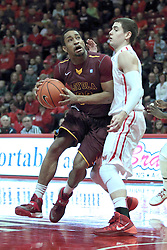 11 January 2014:  Christian Thomas bumps his way past Nick Zeisloft during an NCAA  mens basketball game between the Ramblers of Loyola University and the Illinois State Redbirds  in Redbird Arena, Normal IL.  Redbirds win 59-50