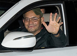 © Licensed to London News Pictures. 26/02/2021. London, UK. Brazilian Wagner Araujo, 43, waves from a car as the first travellers leave the Radisson hotel near Heathrow Airport after their quarantine period ended. New quarantine measures were introduced for travellers form red list countries, who are required to isolate for ten days in a hotel at a cost of £1,750 per person. Photo credit: Ben Cawthra/LNP