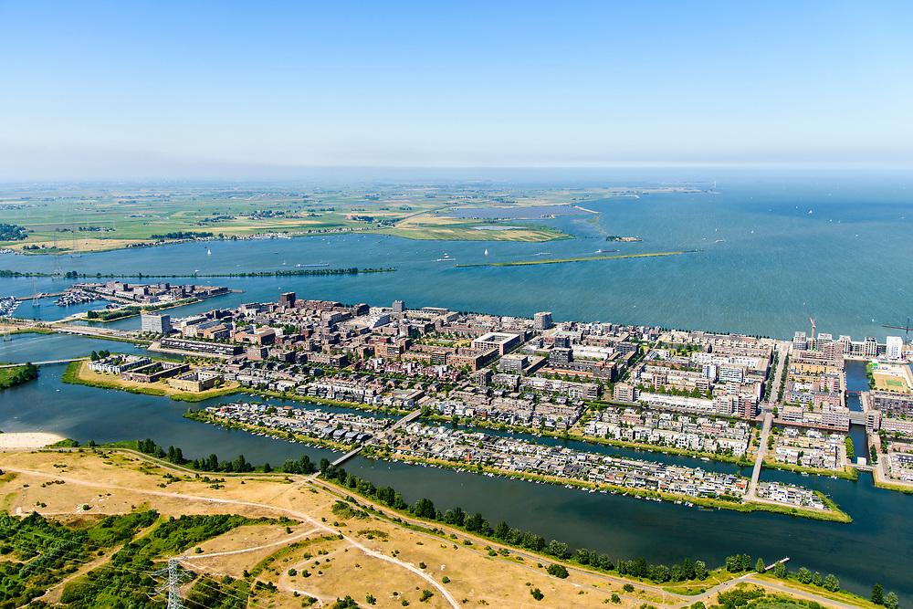 Nederland, Noord-Holland, Amsterdam, 29-06-2018; IJburg, woonwijk aangelegd op kunstmatige - aangeplemte - eilanden. Haveneiland met in de voorgrond Diemerpark (Diemer Zeedijk).<br /> IJburg, residential area built on artificial islands.<br /> luchtfoto (toeslag op standard tarieven);<br /> aerial photo (additional fee required);<br /> copyright foto/photo Siebe Swart