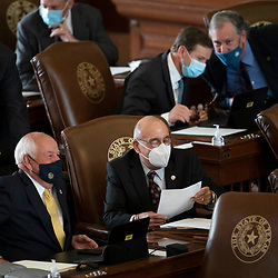 Austin, TX USA March 31, 2021:  State Rep. Bobby Guerra, D-McAllen, on the floor of the Texas House of Representatives during routine bill readings at the 87th Texas legislative session. Emergency bills include power company regulation, border security and the coronavirus response.