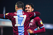 Levi Sutton of Scunthorpe United (22) scores a goal and celebrates with Lee Novak of Scunthorpe United (17) to make the score 2-0 during the EFL Sky Bet League 1 match between Scunthorpe United and Coventry City at Glanford Park, Scunthorpe, England on 5 January 2019.