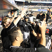 J.T. Realmuto, MIami Marlins, is congratulated by team mates in the dugout after hitting a home run during the New York Mets Vs Miami Marlins MLB regular season baseball game at Citi Field, Queens, New York. USA. 16th September 2015. Photo Tim Clayton