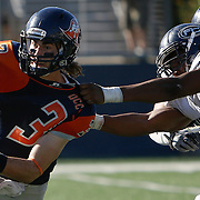 The Orange Coast College Pirates football teams sophomore quarterback (3) Kody Whitaker (left) gets sacked by The Fullerton College Hornets sophomore defensive line (91) Montre Bonner (right). The Hornets would win 35-14  away in Huntington Beach Calif., on November 6th 2016. Photo By: Daniel Bowyer / Sports Shooter Academy